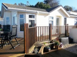 LUXURY LODGE at Waterside Park Paignton with private parking space and fantastic sea views. Prime secluded location with private garden, decking and FREE WIFI.