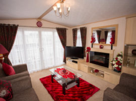 Beautifully furnished very spacious dog friendly ABI Kentmere has a large wrap around decking with luxury rattan suite.CH,DG,3pc suite,40in tv, Skyfeed, washing machine, 6ft fridge/freezer. Main bedroom has king size bed,en-suite shower room,TV