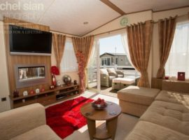 Beautiful Platinum Standard ABI ST David Caravan with large wrap around Veranda, 3 bedrooms all with tv's, en-suite. CH, DG, Dishwasher, *Sky, Xbox 360 and games
