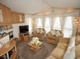 Beautiful Dog Friendly Willerby Winchester caravan has central heating, double glazing, tv's in all bedrooms, Sky feed, large decking
