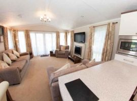 Luxurious top spec Pemberton Park Lane Vista lodge has washer/dryer, dishwasher, fridge/freezer, full size bath, central heating, double glazing, Sky. Master bedroom has en-suite shower room, all bedrooms have tv's. Patio doors open on to a large wrap around decking with seating.