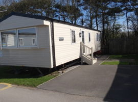 Private 2 bedroom caravan for hire located at Lakeland, Nr Grange-over-Sands, South Lakes, Cumbria. Double glazed, central heated. Sleeps 6 guests.