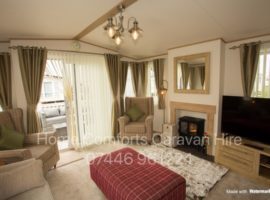 Stunning Top Of The Range Luxury Caravan - washing machine, dishwasher, fridge/freezer, full size bath, en-suite shower room, Sky connection, tv's in both bedrooms, decking with luxury seating, ample private parking